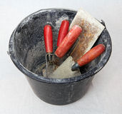 Bucket with masonry tools Stock Photography