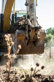 Bucket and mechanical arm of the excavator in motion stock photo