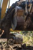 Bucket and mechanical arm of the excavator in motion royalty free stock images