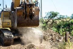 Bucket and mechanical arm of the excavator in motion royalty free stock image