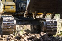 Bucket and mechanical arm of the excavator in motion royalty free stock photography