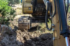 Bucket and mechanical arm of the excavator in motion stock images