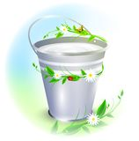 Bucket with milk Stock Photo