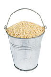 Bucket with millet Stock Photos