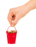 Bucket of money Stock Photo