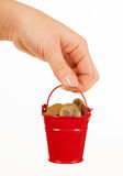 Bucket of money in hand Royalty Free Stock Images