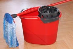 Bucket with a mop Stock Photos