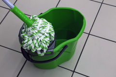 A bucket and mop for cleaning the premises. Stock Photos