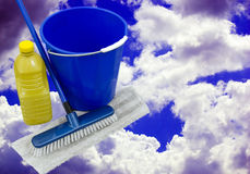 Bucket and mop over a blue cloudy sky Royalty Free Stock Photography