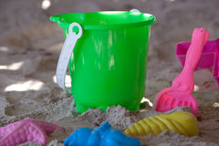 Bucket with moulds and spade on a beach Stock Photo