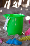 Bucket with moulds and spade on a beach Stock Photography