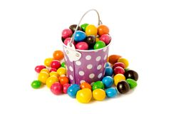 Bucket Nuts in a multi-colored glaze dragee. On a white background isolation Stock Photo