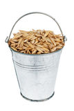 Bucket with  oats Stock Images