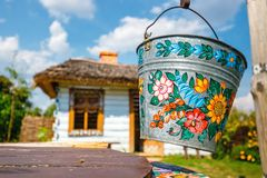 A bucket over a well in the colorful village - Zalipie, Poland. It is known for a local custom. Zalipie, Poland, August 19, 2018: A bucket over a well in the stock image