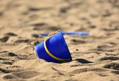 Bucket / Pail and Spade / Shovel on sand royalty free stock photography
