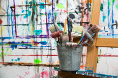 Bucket of painter's brushes. In atelier Stock Photography