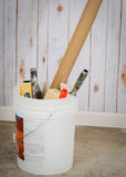 Bucket of painting supplies. Bucket holding painting supplies Stock Image