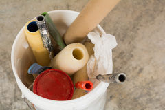 Bucket of painting supplies. Bucket holding paint rollers, handles and other supplies Stock Photos