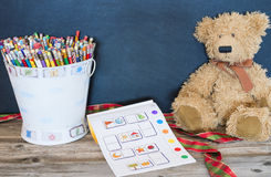 Bucket of pencils, old bear. And coloring book royalty free stock photography