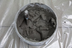 Bucket with plaster and the spatula Royalty Free Stock Image