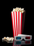 Bucket of popcorn with 3D glasses Royalty Free Stock Image