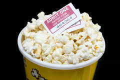 Bucket of popcorn with movie ticket Royalty Free Stock Photography