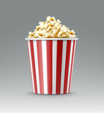 Bucket of popcorn. Vector white and red striped bucket of popcorn kernels close up side view  on gray background Stock Image