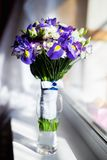 A Bucket of purple flowers Royalty Free Stock Images