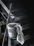 Bucket and rag charcoal drawing. This is an original drawing of a pail or bucket, a rag and a broom handle at the foot of the stairs. This charcoal drawing was royalty free illustration