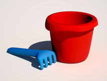 Bucket and rake. Red bucket and blue rake for playing with sand Royalty Free Stock Photos