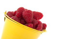 Bucket raspberries stock photos