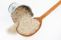 Bucket of rice crumbles in the a wooden spoon Royalty Free Stock Images