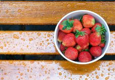 fresh strawberries on a bench Royalty Free Stock Photography