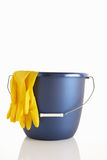 Bucket and rubber gloves Royalty Free Stock Photo