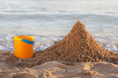 Bucket and the sand Stock Image