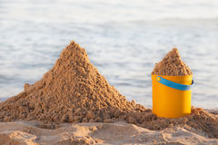 Bucket and the sand Royalty Free Stock Photo