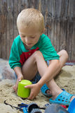 Bucket on the sand boy Stock Photos