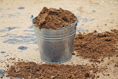 Bucket with sand Stock Photos