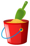 Bucket of sand and green spoon Stock Image