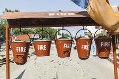 Bucket with sand in a petrol station for fire fighting Stock Image