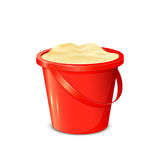 Bucket with sand Stock Images