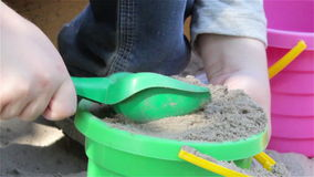Bucket with sand in sandbox. A bucket of sand sandbox shovel vysapaye, play with in the sand with a bucket children stock video footage