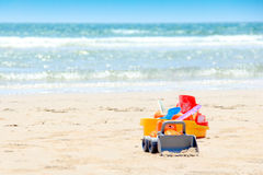 A bucket and sand toys for the children play time at the beach Royalty Free Stock Photo