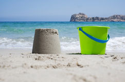 Bucket and sandcastle Stock Photos