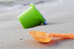 Bucket and scoop. Toy bucket and scoop on beacj Stock Photos
