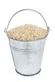 Bucket with sesame seeds Stock Photo