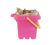 Bucket with shells Royalty Free Stock Photo