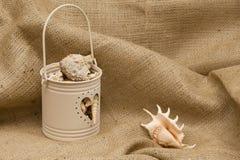 Bucket of shells Stock Photos