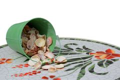Bucket of shells spilling onto mosaic table Stock Photography