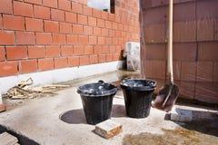 Bucket and shovel. Under construction Royalty Free Stock Photos